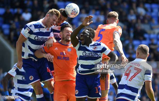 Michael Morrison of Reading Sean Morrison of Cardiff City and Andy Yiadom of Cardiff City compete for a corner during the Sky Bet Championship match...
