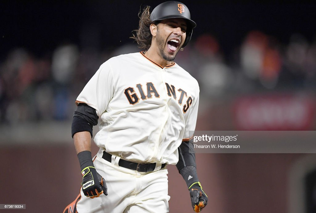 Michael Morse #38 of the San Francisco Giants celebrates as he trots around the bases after his solo home run to tie the score 3 -3 against the Los Angeles Dodgers in the bottom of the eighth inning at AT&T Park on April 26, 2017 in San Francisco, California.