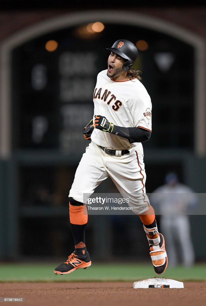 Michael Morse #38 of the San Francisco Giants celebrates as he trots around the bases on his solo home run to tie the score 3-3 against the Los Angeles Dodgers in the bottom of the eighth inning at AT&T Park on April 26, 2017 in San Francisco, California.