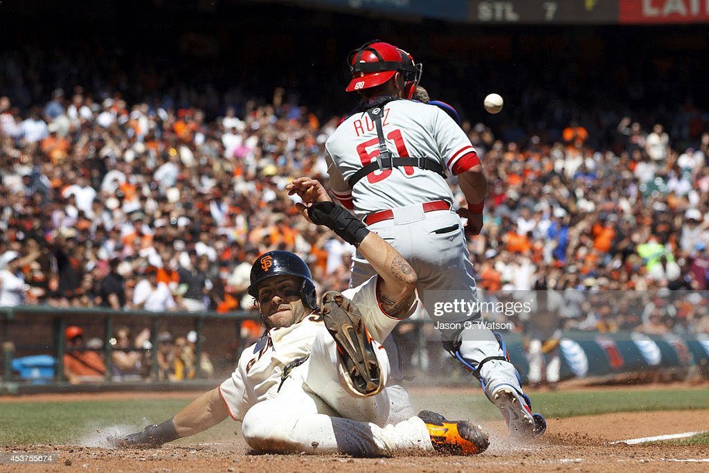 Michael Morse #38 of the San Francisco Giants slides into home plate to score a run past Carlos Ruiz #51 of the Philadelphia Phillies during the fourth inning at AT&T Park on August 17, 2014 in San Francisco, California.