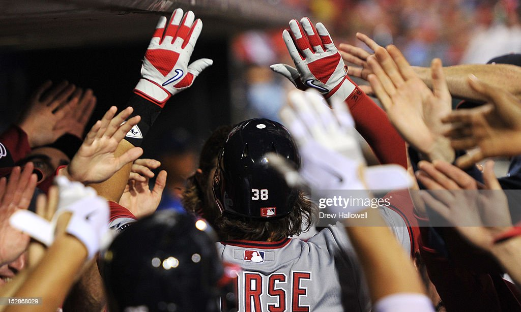 Michael Morse #38 of the Washington Nationals is congratulated by teammates after hitting a home run during the game against the Philadelphia Phillies at Citizens Bank Park on September 27, 2012 in Philadelphia, Pennsylvania. The Nationals won 7-3.