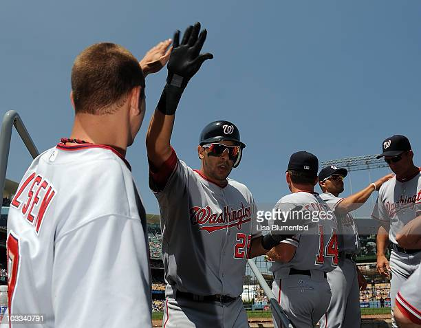 Michael Morse of the Washington Nationals returns to the dugout after hitting a homerun in the second inning against the Los Angeles Dodgers at...