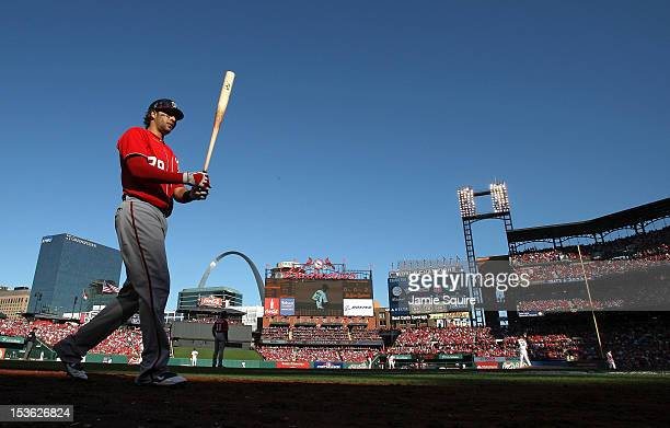 Michael Morse of the Washington Nationals walks to the on deck circle in the fifth inning against the St Louis Cardinals during Game One of the...