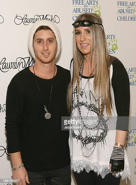 Michael Moshi and Lauren Moshi attend the 'Lauren Moshi Gallery for Free Arts for Abused Children' event at Lauren Moshi Gallery on December 6 2011...