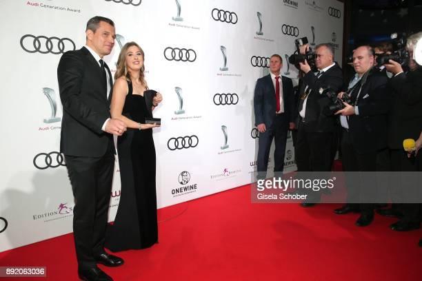 Michael Mronz and GinaMaria Schumacher daughter of of Michael Schumacher with award during the Audi Generation Award 2017 at Hotel Bayerischer Hof on...