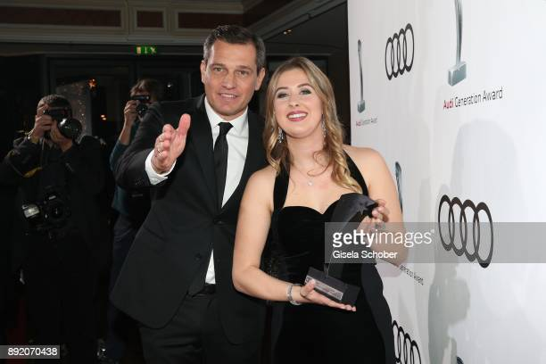 Michael Mronz and GinaMaria Schumacher daughter of of Michael Schumacher with award during the Audi Generation Award 2017 at Hotel Bayerischer Hof on...
