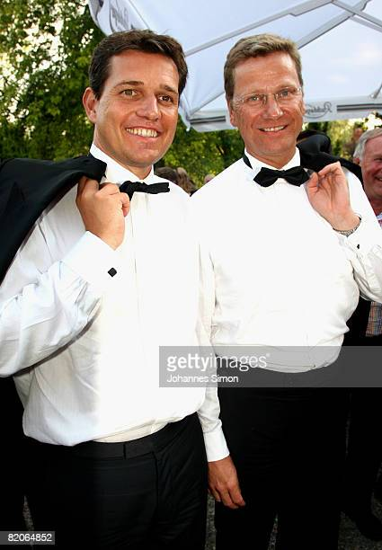 Michael Mronz and partner Guido Westerwelle arrive for the 'Parsifal' premiere of the Richard Wagner festival on July 25 2008 in Bayreuth Germany