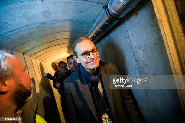 Michael Mueller, Major of Berlin, peers in a restored tunnel once used in an attempt to help people escape from East Berlin into West Berlin on...