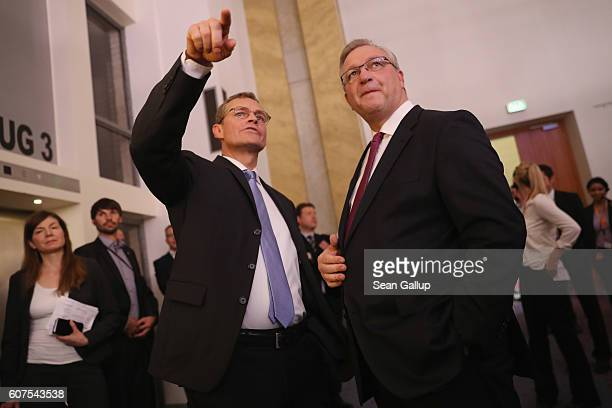 Michael Mueller mayor of Berlin and German Social Democrat and Frank Henkel lead candidate of the German Christian Democrats chat prior to interviews...