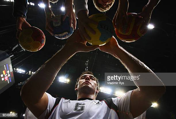 Michael Mueller of Germany gives autographs after the Supercup 2009 game between Germany and Norway at Lanxess Arena on October 29 2009 in Cologne...