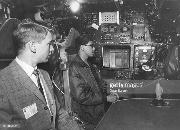 MAY 6 1969 MAY 7 1969 Michael Mundt Left and Charles Abernethy Try out B52 Simulator Mundt of Thomas Jefferson and Abernethy of Manual High School...