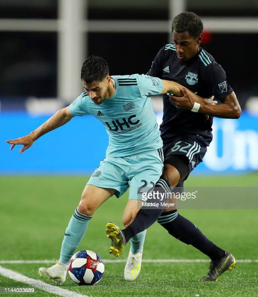 Michael Murillo of New York Red Bulls defends Carles Gil of New England Revolution during the first half of the game at Gillette Stadium on April 20...