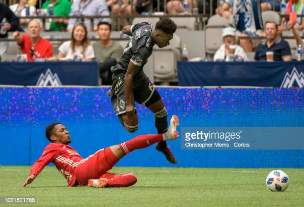 Michael Murillo of New York Red Bulls tackles Alphonso Davies of Vancouver Whitecaps at BC Place on August 18 2018 in Vancouver Canada