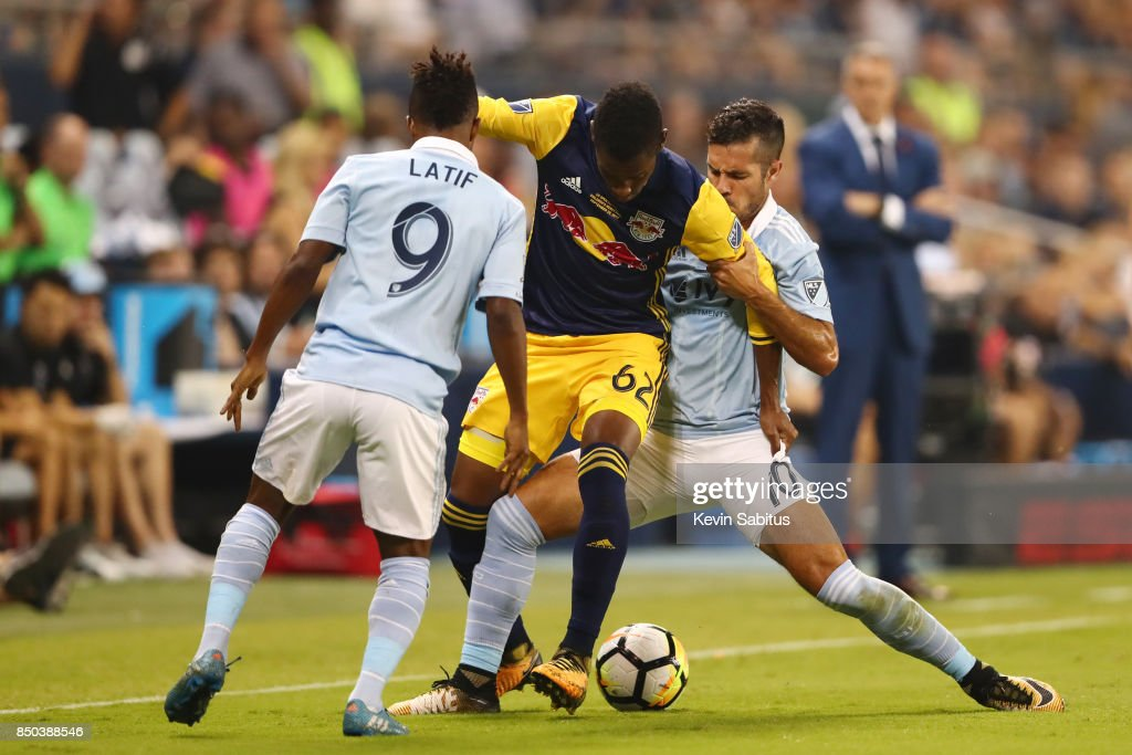 Michael Murillo #62 of the New York Red Bulls controls the ball between two Sporting Kansas City players in the US Open Cup Final match at Children's Mercy Park on September 20, 2017 in Kansas City, Kansas.