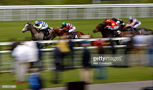 Michael Murphy riding Quench Dolly win The Spitfire Novice Auction Stakes at Goodwood racecourse on May 20 2016 in Chichester England