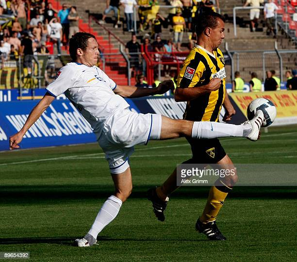 Michael Mutzel of Karlsruhe clears the ball ahead of Szilard Nemeth of Aachen during the Second Bundesliga match between Karlsruher SC and Alemannia...