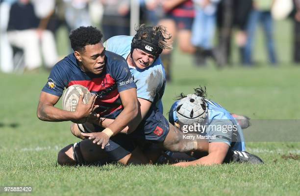 Michael Naitokani of Hastings Boys High School is tackled during the Schools Super 8 match between Hastings Boys High and Napier Boys High at...