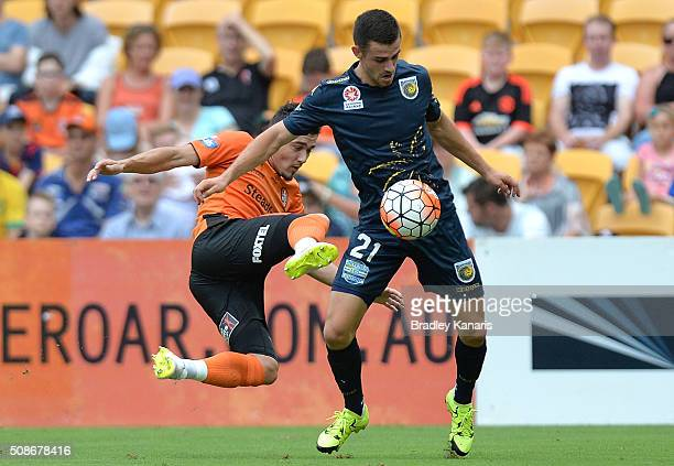 Michael Neill of the Mariners is challenged by Dimitri Petratos of the Roar during the round 18 ALeague match between the Brisbane Roar and Central...