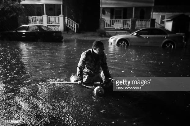 Michael Nelson floats in a boat made from a metal tub and fishing floats after the Neuse River went over its banks and flooded his street during...
