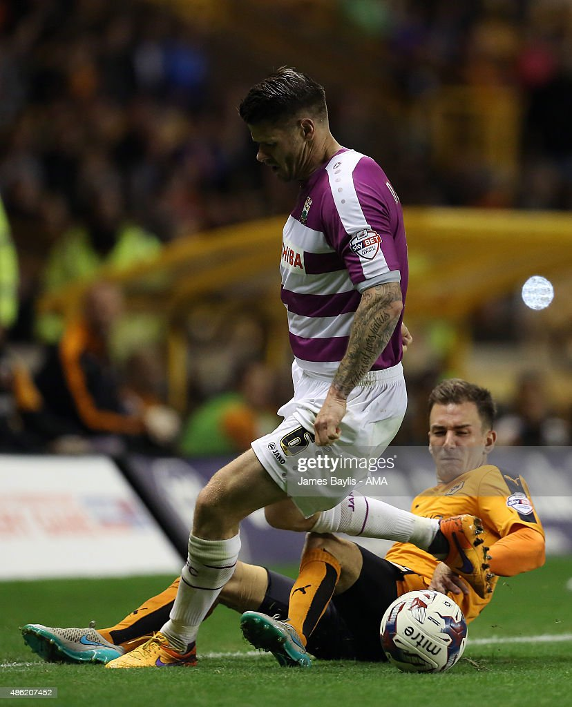 Michael Nelson of Barnet and Jed Wallace of Wolverhampton Wanderers during the Capital One Cup match between Wolverhampton Wanderers and Barnet at Molineux on August 25, 2015 in Wolverhampton, England.