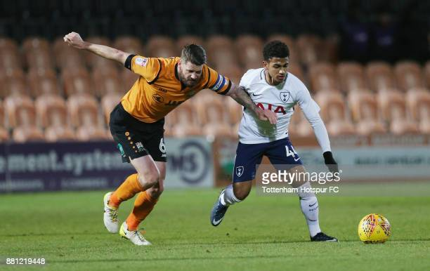 Michael Nelson of Barnet and Marcus Edwards of Tottenham during the Checkatrade Trophy match between Barnet and Tottenham Hotspur U23 at The Hive on...