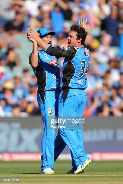Michael Neser and Travis Head of the Strikers celebrate the wicket of Tim Paine of the Hurricanes during the Big Bash League Final match between the...