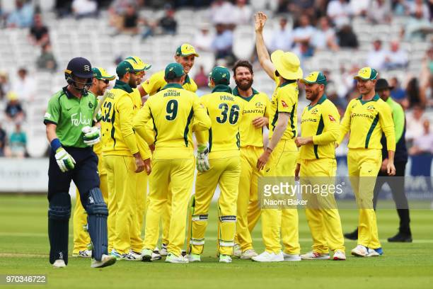 Michael Neser of Australia celebrates with his team after he catches the ball to dismiss Nick Gubbins of Middlesex during the Middlesex and Australia...