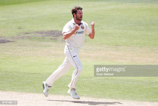 Michael Neser of Queensland celebrates after dismissing Marcus Harris of Victoria during day two of the Sheffield Shield match between Victoria and...