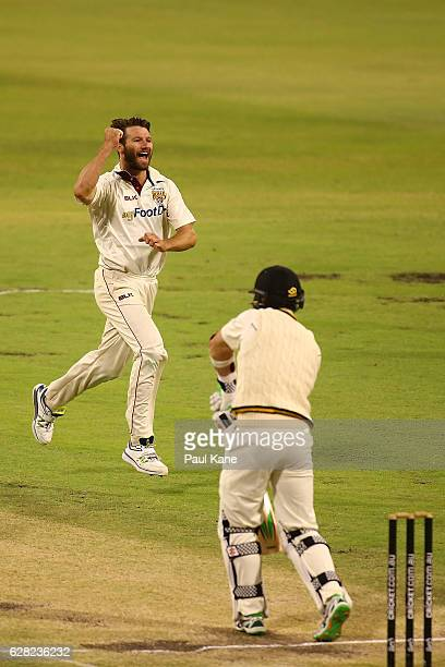 Michael Neser of Queensland celebrates the wicket of Michael Klinger of Western Australia during day three of the Sheffield Shield match between...