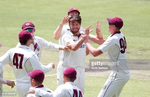 Michael Neser of Queensland is congratulated by his teammates after dismissing Marcus Harris of Victoria during day two of the Sheffield Shield match...