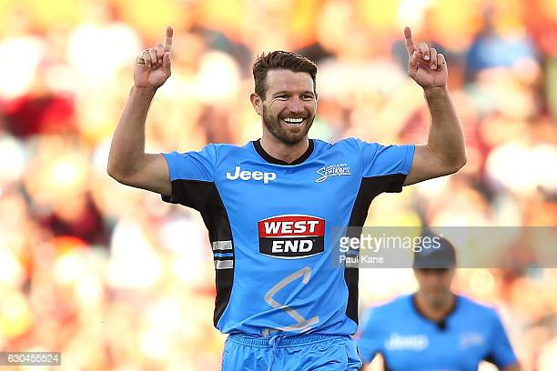Michael Neser of the Strikers celebrates the wicket of Michael Klinger of the Scorchers during the Big Bash League between the Perth Scorchers and...