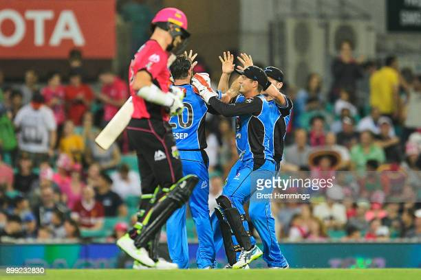Michael Neser of the Strikers celebrates victory with team mates after taking the wicket of Stephen O'Keefe of the Sixers during the Big Bash League...