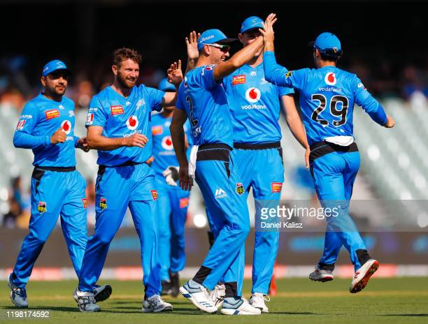Michael Neser of the Strikers celebrates with his team mates during the Big Bash League match between the Adelaide Strikers and the Sydney Sixers at...