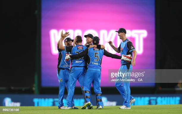 Michael Neser of the Strikers celebrates with team mates after dismissing Steve O'Keefe of the Sixers during the Big Bash League match between the...