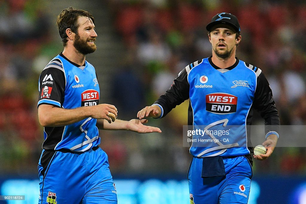 Michael Neser of the Strikers celebrates with Travis Head of the Strikers after taking the wicket of Ben Rohrer of the Thunder during the Big Bash League match between the Sydney Thunder and the Adelaide Strikers at Spotless Stadium on January 7, 2018 in Sydney, Australia.