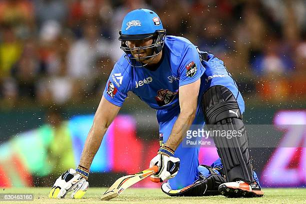 Michael Neser of the Strikers slips on the pitch during the Big Bash League between the Perth Scorchers and Adelaide Strikers at WACA on December 23...