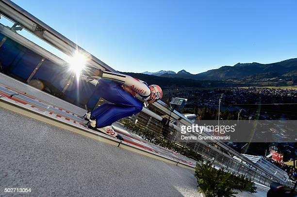 Michael Neumayer of Germany accelerates down the jumping hill during his training jump on Day 1 of the 64th Four Hills Tournament ski jumping event...