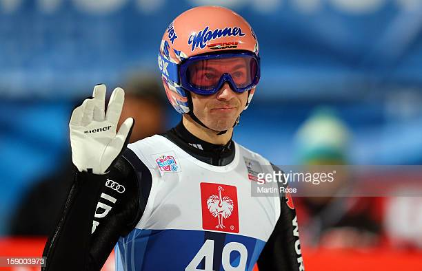 Michael Neumkayer of Germany reacts during the qualification round of the FIS Ski Jumping World Cup event at the 61st Four Hills ski jumping...