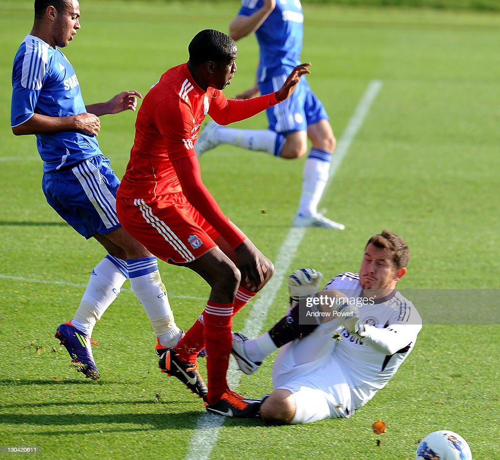 Michael Ngoo of Liverpool takes on Rhys Taylor of Chelsea during the Barclays Premier Reserve League match between Liverpool Reserves and Chelsea Reserves on October 26, 2011 in Liverpool, England.