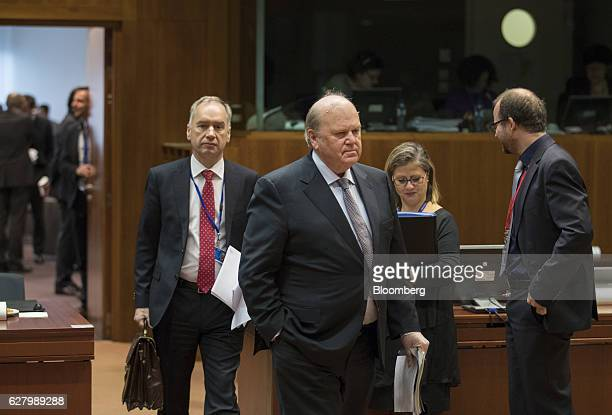 Michael Noonan Ireland's finance minister center arrives ahead of an Ecofin meeting of European Union finance ministers in Brussels Belgium on...