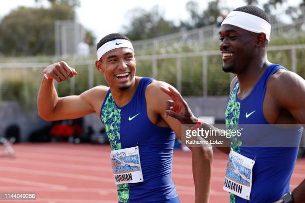Michael Norman and Raj Benjamin both running for Nike pose following their finish in the 400 meter dash on the second day of the 61st Mt SAC Relays...
