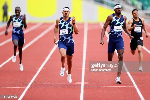 Michael Norman and Rai Benjamin finish in first and second place respectively in the 400 meter final during the USATF Grand Prix at Hayward Field on...
