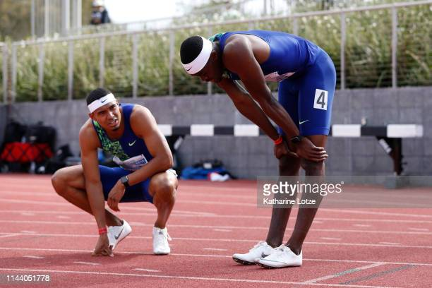 Michael Norman and Raj Benjamin rest following their first and second place finishes in the men's 400 meter dash on the second day of the 61st Mt SAC...