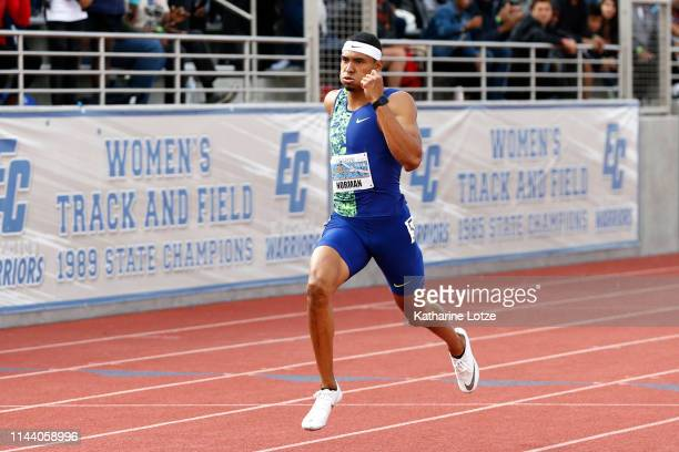Michael Norman crosses the finish line of the men's 400 meter dash on the second day of the 61st Mt SAC Relays at Murdock Stadium at El Camino...