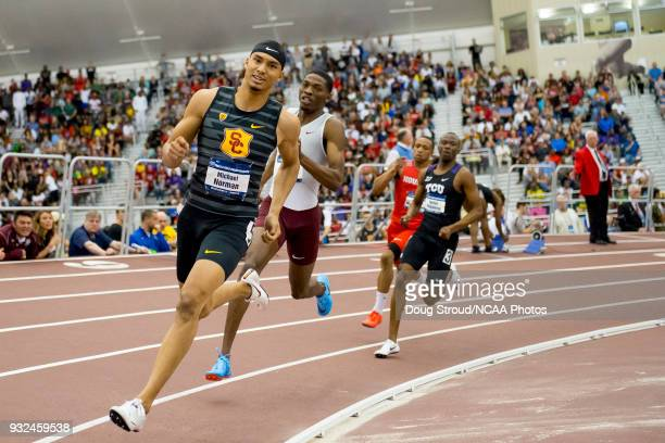 Michael Norman of the University of Southern California leads the field in the 400 meter dash during the Division I Menu2019s and Womenu2019s Indoor...
