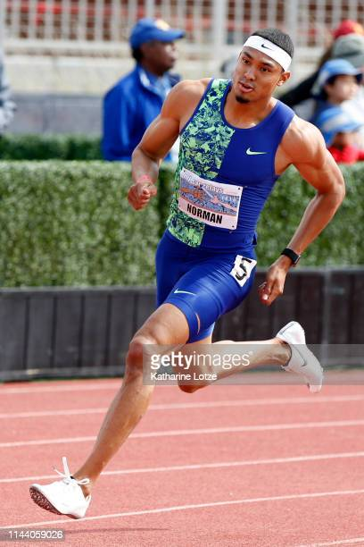 Michael Norman rounds the first turn of the men's 400 meter dash on the second day of the 61st Mt SAC Relays at Murdock Stadium at El Camino College...