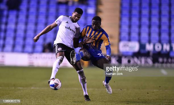 Michael Nottingham of Accrington Stanley and Daniel Udoh of Shrewsbury battle for the ball during the Sky Bet League One match between Shrewsbury...
