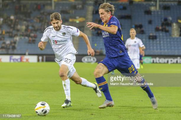 Michael Novak of Wolfsberg AC and Nicolo Zaniolo of AS Roma during the UEFA Champions League group J match between Wolfsberger AC v AS Roma at Merkur...