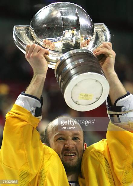 Michael Nylander of Sweden lifts the trophy after his team's 4-0 victory over the Czech Republic in the IIHF World Championship at Riga Arena on May...