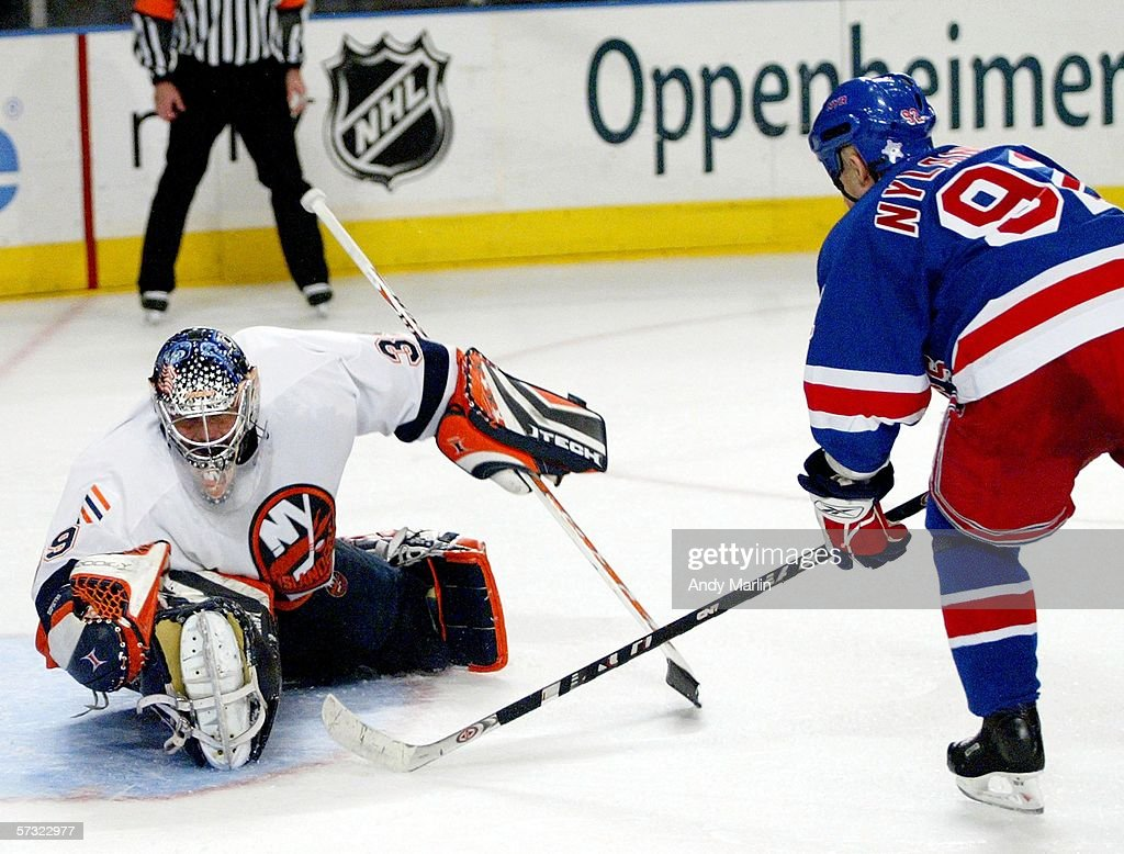 Michael Nylander #92 of the New York Rangers waits for a rebound as Rick DiPietro #39 of the New York Islanders makes a glove save on April 11, 2006 at Madison Square Garden in New York City. The Islanders defeated the Rangers 3-2.